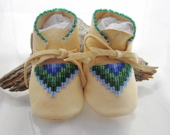 Handmade baby boy moccasins for a unique baby gift idea.