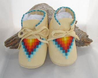 Boho baby shoes in the Native American style of beaded infant moccasins. Keepsake quality handmade moccs as a baby shower gift or birthday