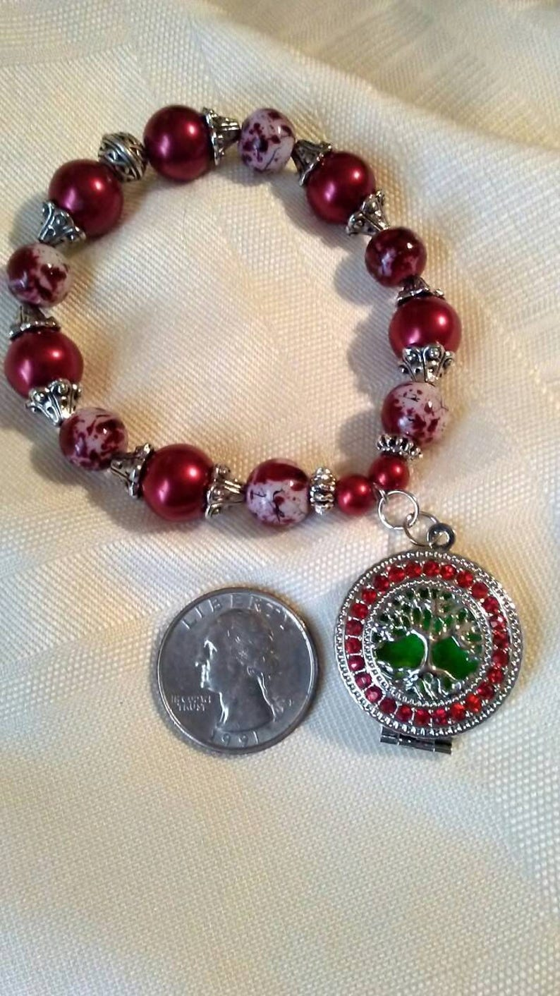 Tree of Life Aroma Therapy hand beaded stretch bracelet in red and silver.