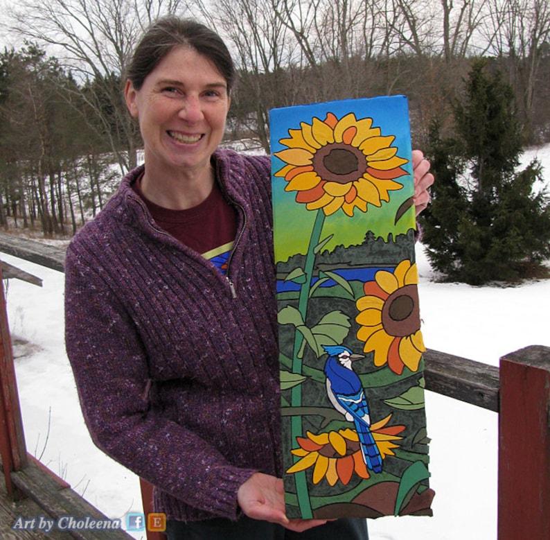 Sunflower w Blue Jay framed in black yellow flower blooms image 0