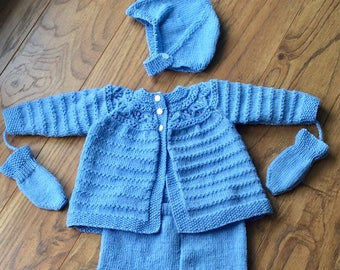 Hand knitted vintage pattern babies pram suit