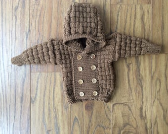 Hand made hooded jacket in merino wool for babies