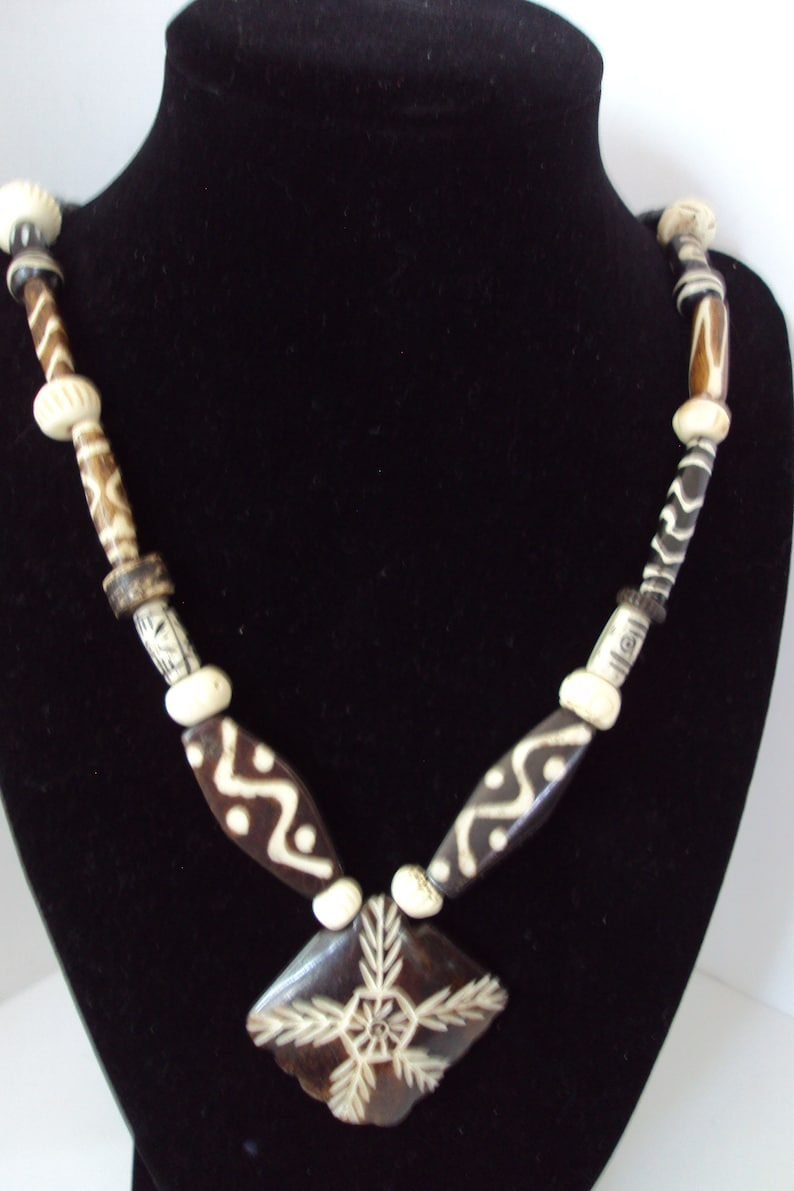 Brown and Etched Bone Necklace with Etched Focal