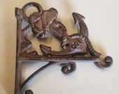 2 pc Cast Iron Anchor Plant Holders, 3 hook positions each wall mount