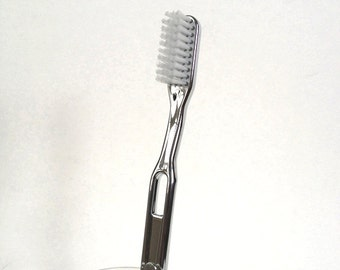 silver toothbrush