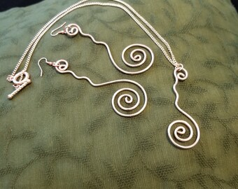 Spiral pendant and necklace in Rose Gold.
