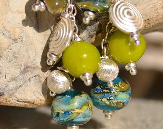 "Long earrings ""Brocéliande forest"" leaf of gold and silver lampwork beads"