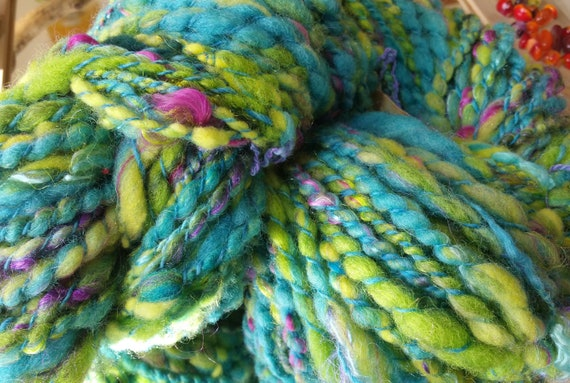 "Skein of yarn spun to spinning wheel""Guiana 1"" wool soft, green and meadow green with purple chips"