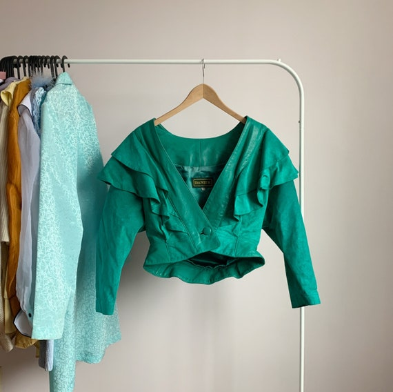 80s glam cropped suede jacket · exaggerated should