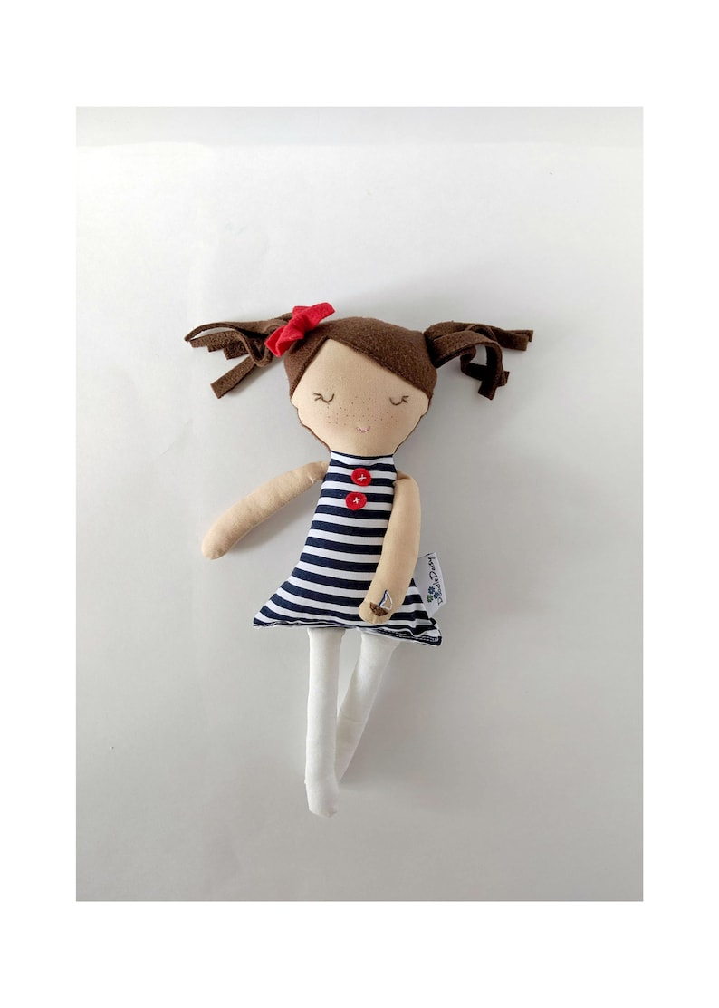 Only 1. Nautical textile doll with bow brown hair. 12' image 0