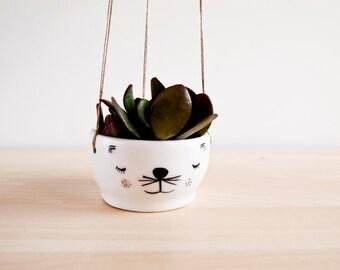 Macetero colgante de cerámica con cara de gato simpatico para techo, paredes o balcones.