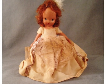 Early Nancy Ann Storebook Doll , U.S.A., Bisque, Redhead, Feather and Gown, Underwear, No. 11