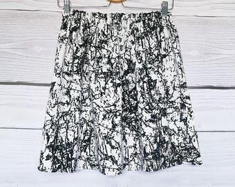 White ink black, cotton skirt black white, cotton string.