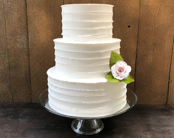 """Fake swirl cake. This cake is 10"""" 8"""" 6"""" The tiers are 4"""" high.  Perfect for a wedding or photo shoot."""