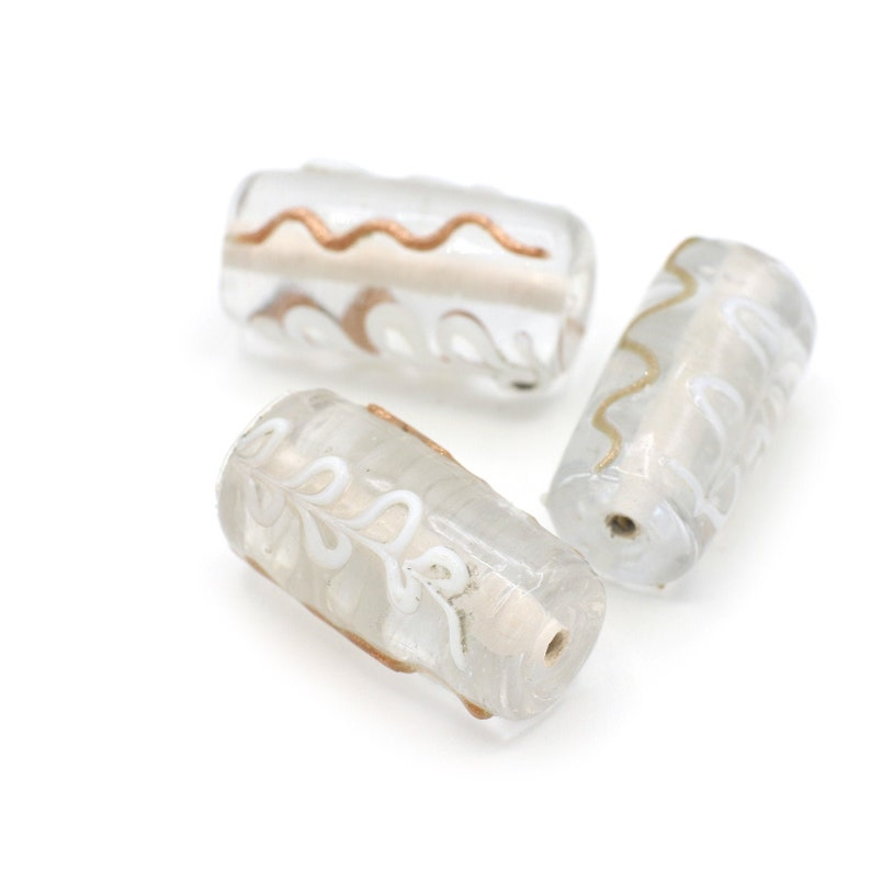 Clear Barrel Shaped Beads with Raised  Squiggles and Flowers of White and Gold 20-25mm 2pcs