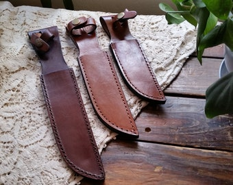 "Fixed Blade Leather Sheath, Fits Clip Point Blades up to 7"" in length, & 1 1/4 "" Wide... Brown Leather Sheath, Strap with Snap"