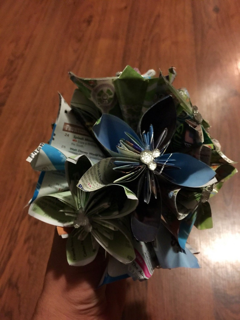 disney wedding bouquet made of disney park maps