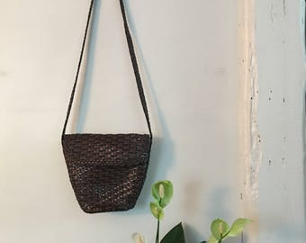 Black and brown woven leather bucket bag purse