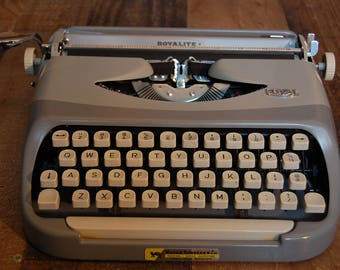 Vintage Royalite Portable Typewriter with factory case and original owners manual, great condition, cleaned and oiled, works well