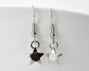 Small star charms, Star earrings. Adorable pair of earrings little stars.