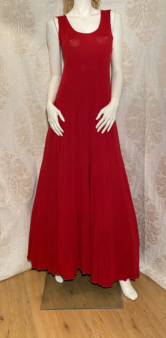 Long, red base dress.