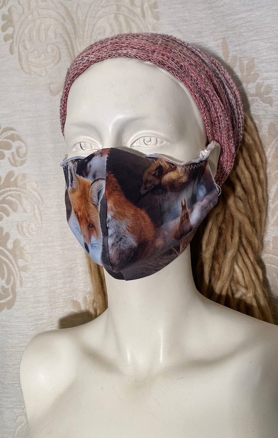 Mouthcaps (2 pieces) with fox print and elastic cord.