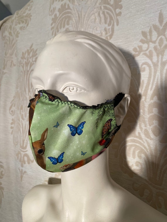 Mouthcaps (2 pieces) with fairy print and elastic cord.