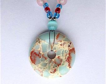 Stunning sea sediment jasper gem stone pendant necklace with cats eye opals.