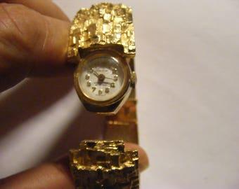 Vintage nugget bangle watch wind-up lucerne gold tone.