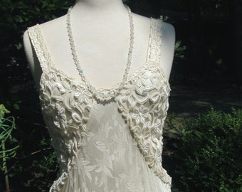 Beautiful Silk Ivory Gown or Wedding Gown trimmed heavily with Venice Laces