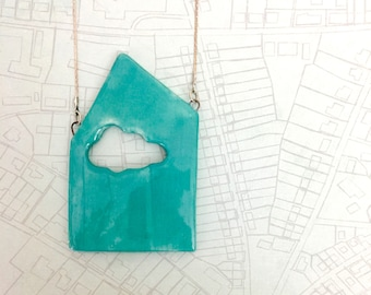 Charity project -Necklace made of chain with a house shaped pendant with cloud