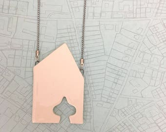 Charity project-Necklace made of chain with a house shaped pendant with a drop