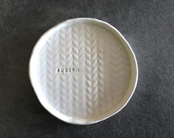 "Plate in white clay with imprinted leaves and the inscription ""AUGURI!"" Best Wishes"