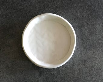 Small white ceramic plate with clouds and stars