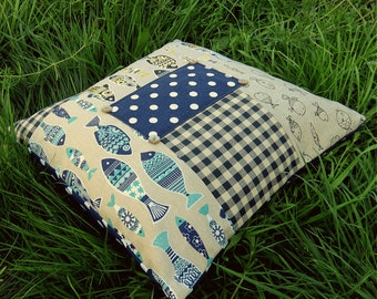 A large patchwork floor cushion.  A floor cushion with a nautical design.  51cm x 51cm.  (20 inches x 20 inches)  Complete with feather pad.