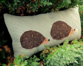 Hedgehogs.  A hedgehogs Cushion made from wool and tweed.  57cm x 30cm.