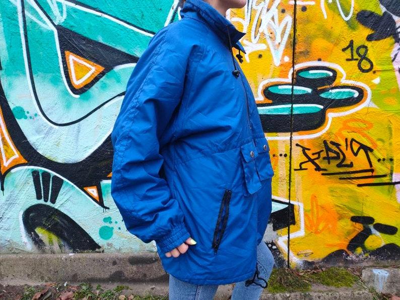 Vintage 90s Unisex Etirel ski snow deep blue jacket with filling.