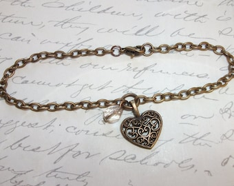Filigree heart charm bracelet with crystal in antique brass / bronze