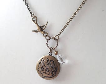 Antique brass engraved locket pendant necklace with bird and crystal drop
