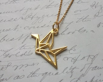 Gold origami bird charm necklace
