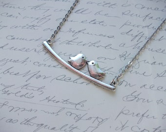 Silver birds on branch necklace