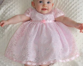 Beautiful Pale Pink Lace Baby Dress Over White Lining