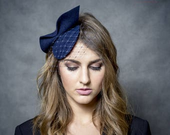 Navy blue mini pill box hat with bow and piece of netting, dark blue fascinator, felt headpiece, small navy hat