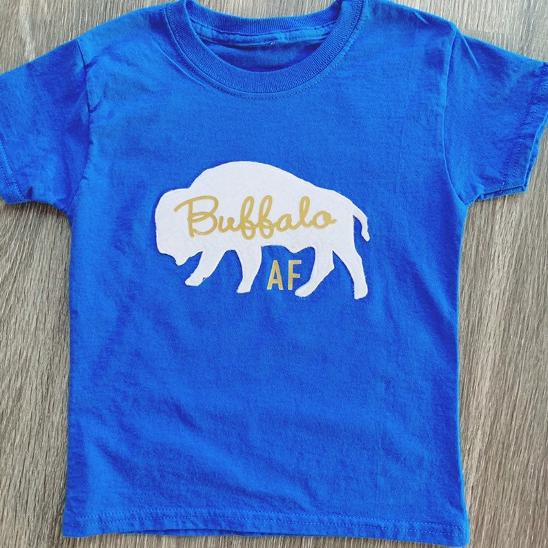 brand new cd9c9 6567a Buffalo Sabres 50th Anniversary Gold Buffalo AF T-Shirt
