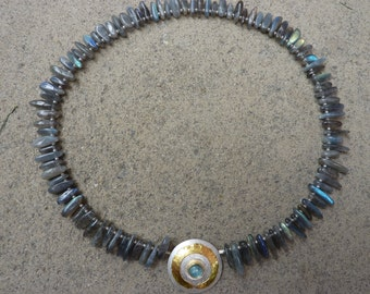 Necklace made of labradorite teeth with  pendant/closing in silver/gold and Aquamarine cabochon