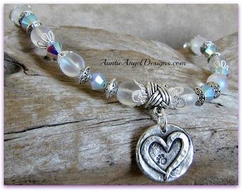 Paw print bracelet, paw print jewelry, pet memorial jewelry, heart dog bracelet, pet sympathy memorial bracelet, pet tribute gift, pet loss