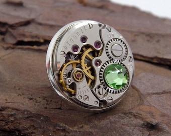 Steampunk Lapel Badge / Tie Tack / Brooch. Vintage Watch Mechanism Silver Pin Badge. Peridot - August Birthstone / 16th Wedding Anniversary