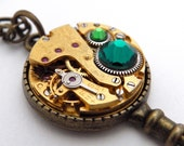 Steampunk Key Necklace / Pendant. With Vintage Brass Watch Mechanism & Emerald and Green Swarovski Crystals. Jamlincrow