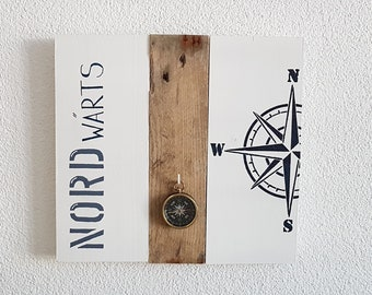 Northwards with compass made of driftwood and wooden board