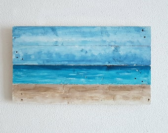 Sea view - picture on saw-raw wooden boards, collage with beach sand, pallets wood